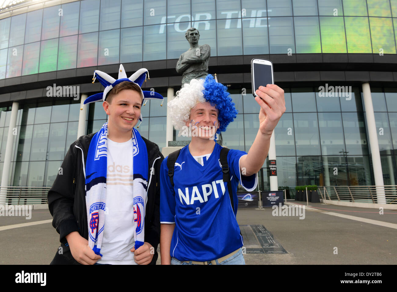 Chesterfield football fans supporters taking photo selfie outside Wembley Stadium Uk - Stock Image