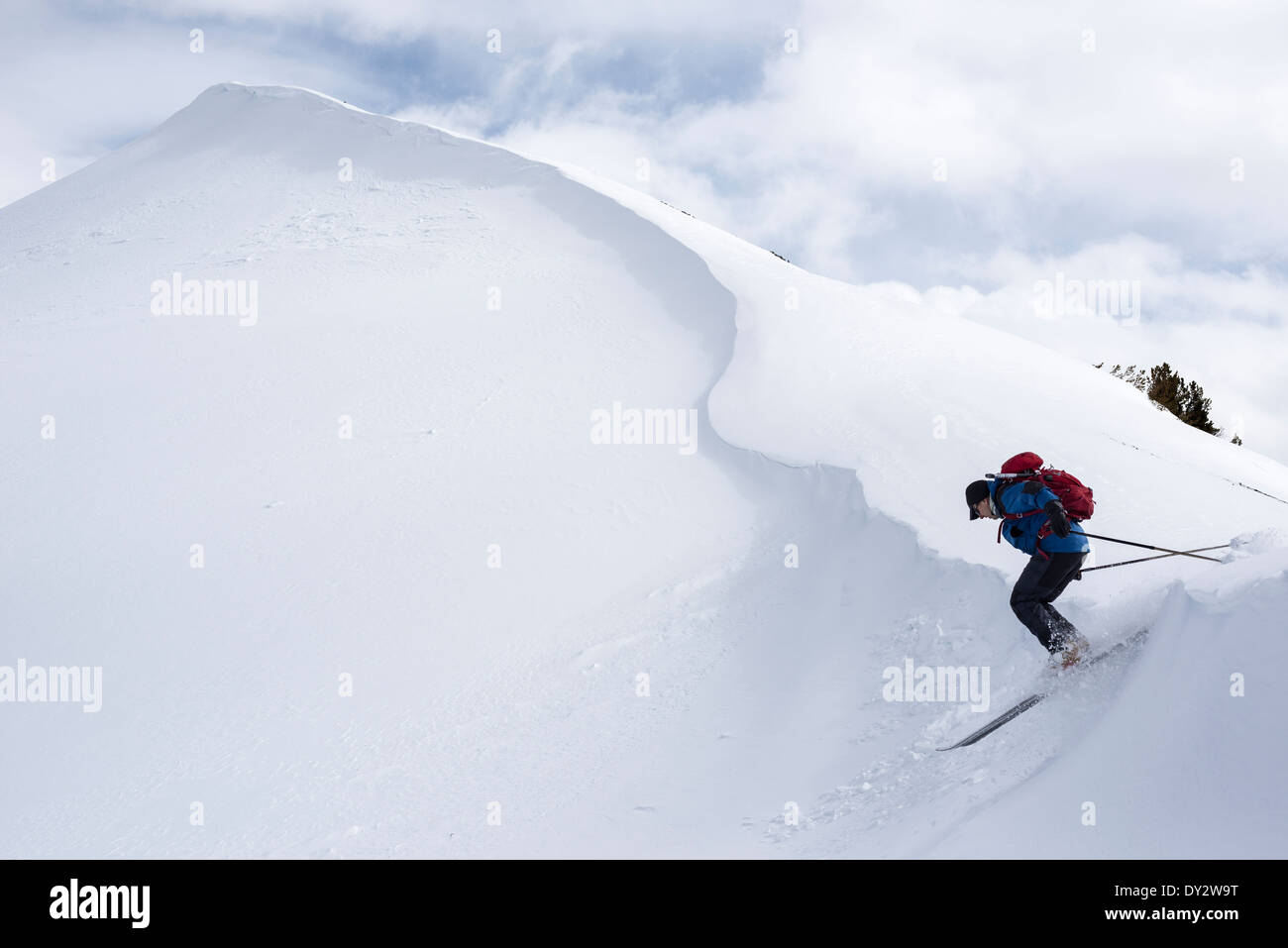 Skiing off a cornice high in Oregon's Wallowa Mountains. - Stock Image