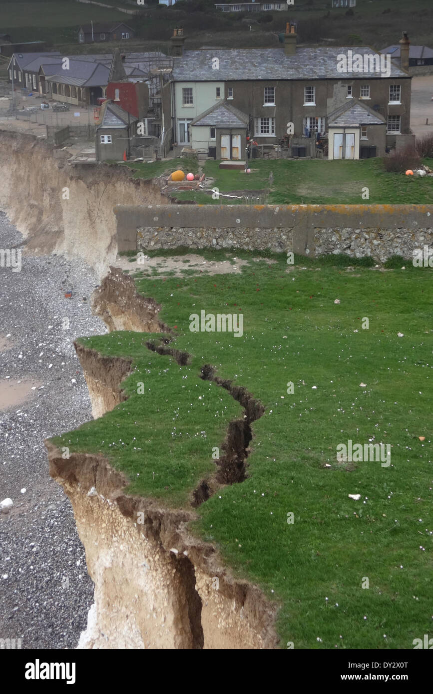 Birling Gap, East Sussex, UK..3 April 2014..Coastguard warn of rockfall risk along the chalk cliff tops near Beachy Head. This crack is typical, the earth crack above hiding a chasm below. Photographer used special equipment to take these pictures and did not take risks. David Burr/Alamy Live News - Stock Image