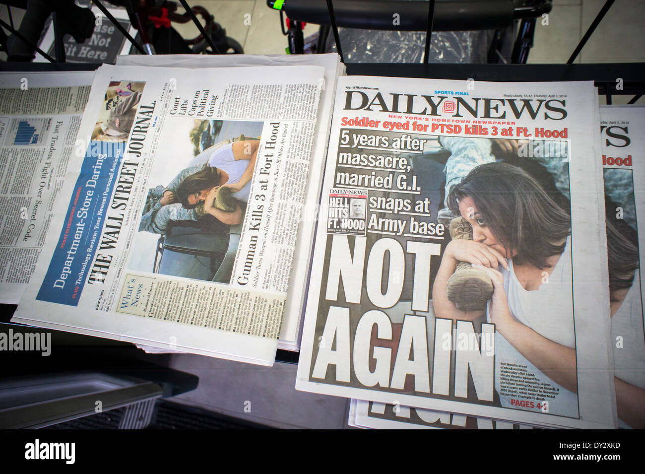 Front pages of the New York Daily News and the Wall Street Journal ...