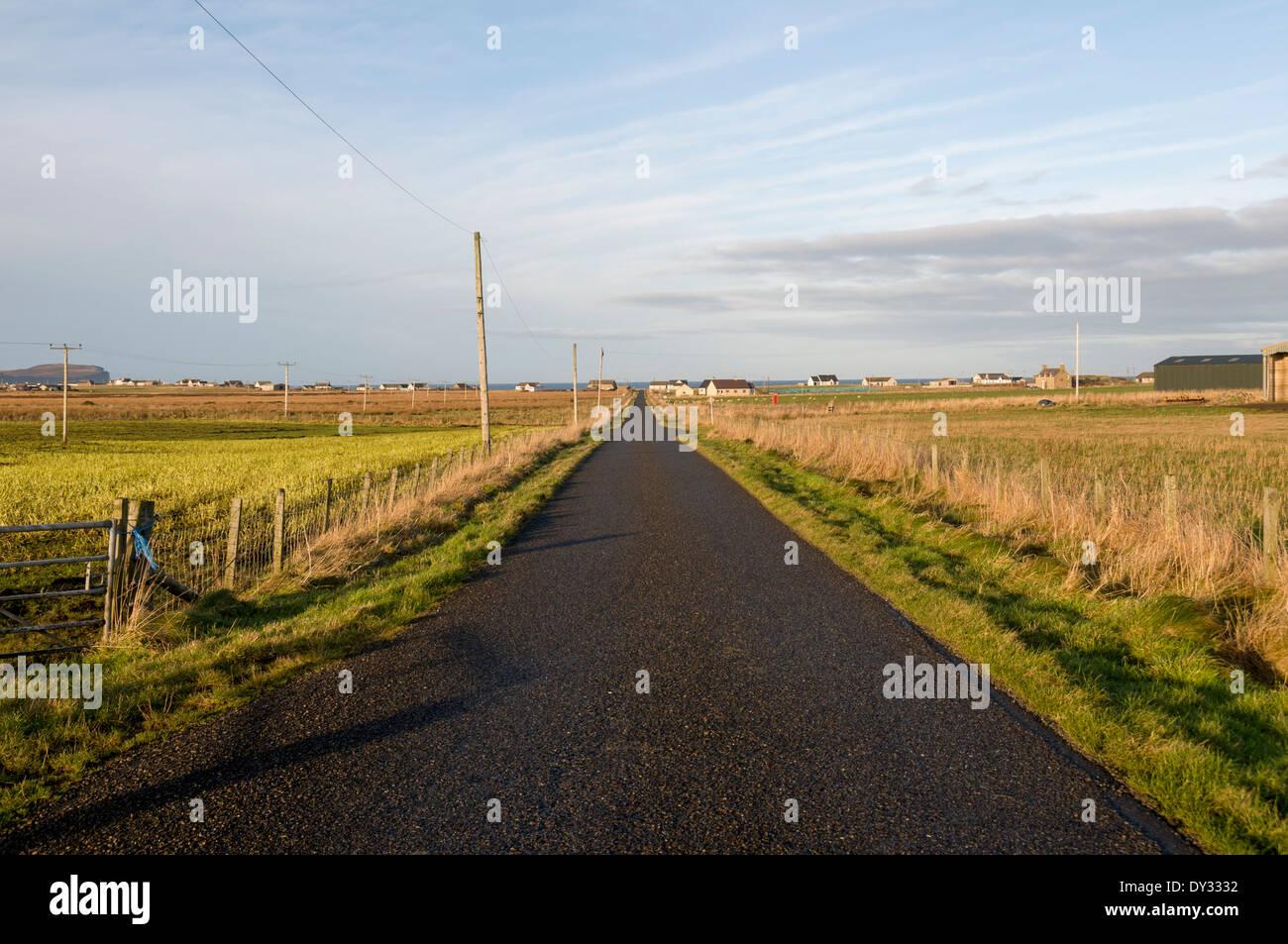 A long straight road near Skarfskerry, Caithness, Scotland, UK - Stock Image