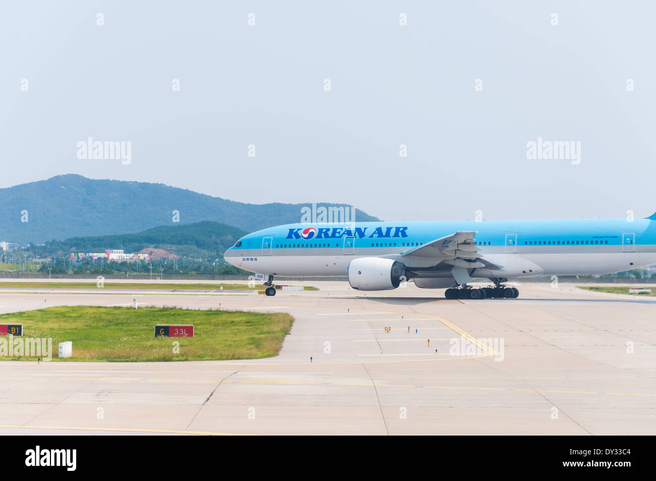 A Korean Air plane taxis to the runway to prepare for takeoff. - Stock Image