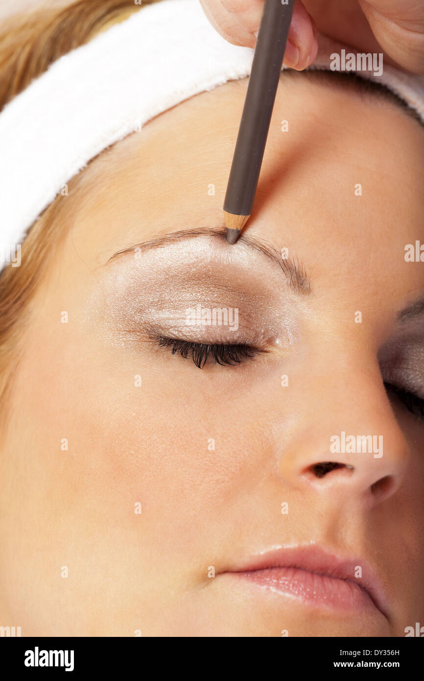 Beautician Applying Eyebrow Pencil For Darkening The Eyebrows Of A