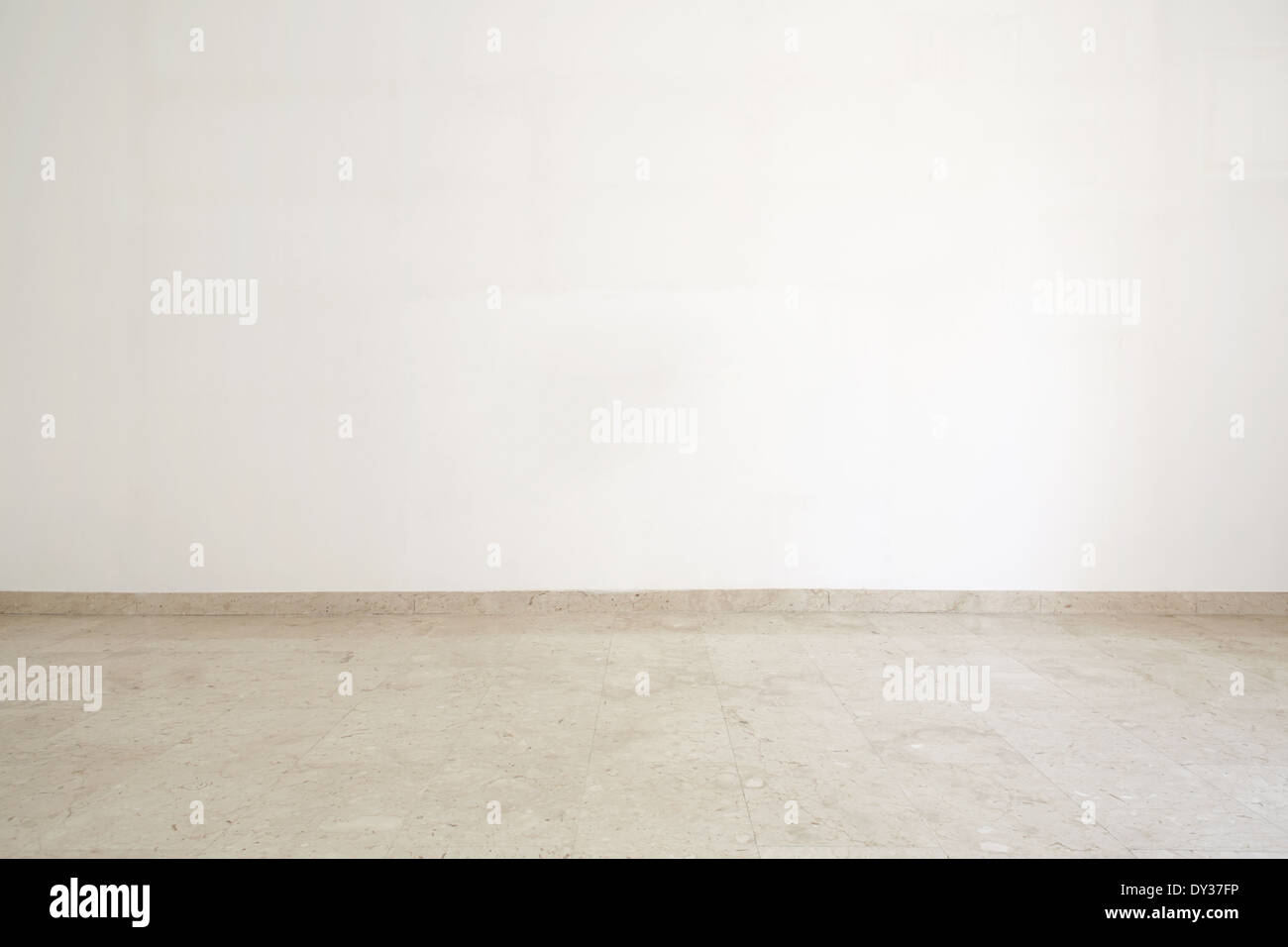 Empty room with marble floor and white wall - Stock Image