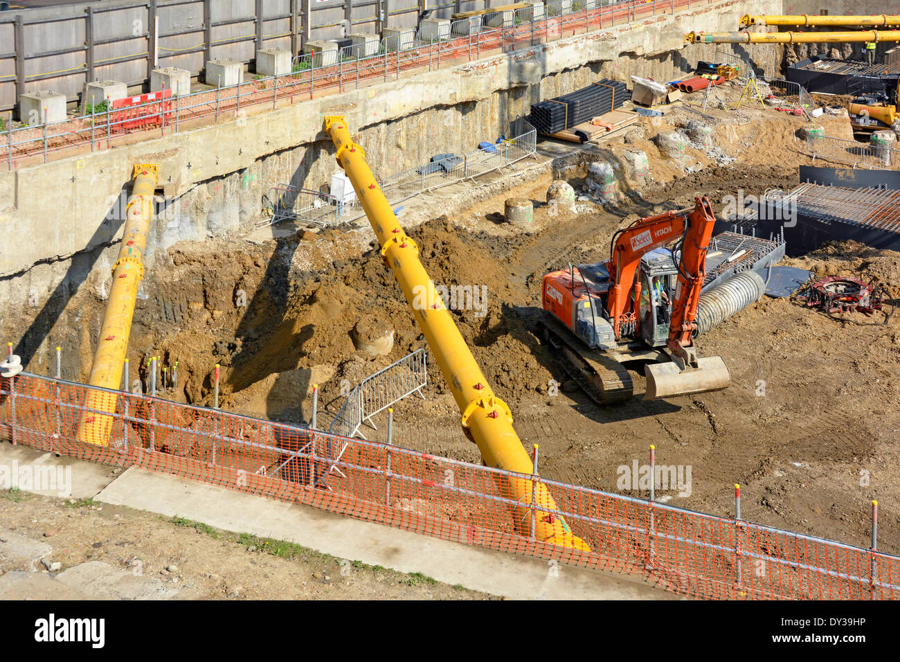 Diagonal shoring struts in pace across corners of retaining walls on large construction site - Stock Image
