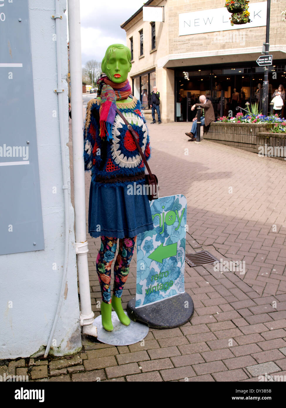 Green mannikin advertizing retro clothes store, Truro, Cornwall, UK - Stock Image