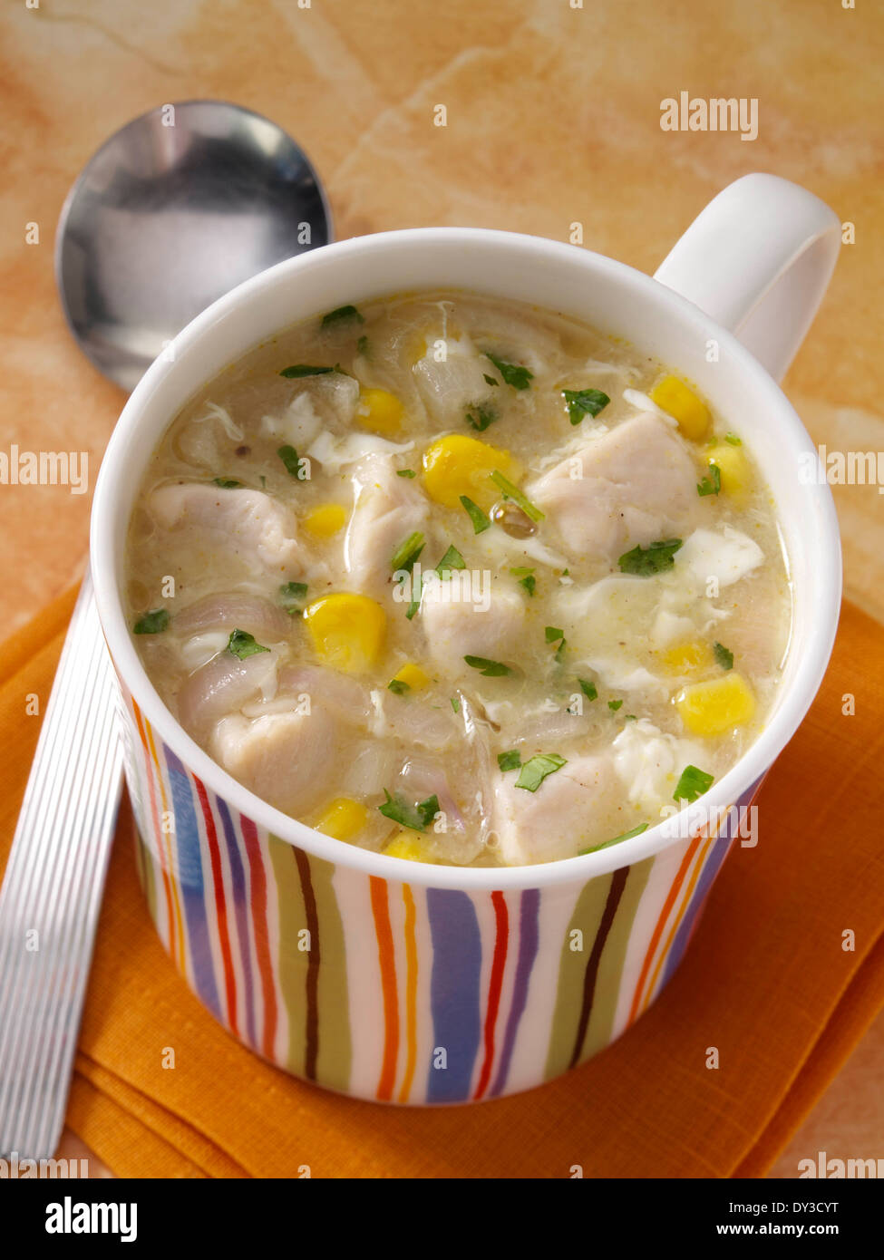 A mug of Chicken sweetcorn soup student meal - Stock Image