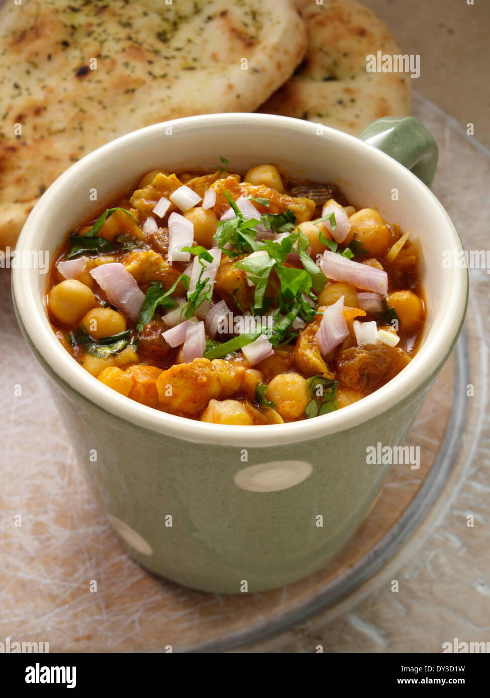 Chicken curry microwaved in a mug - Stock Image
