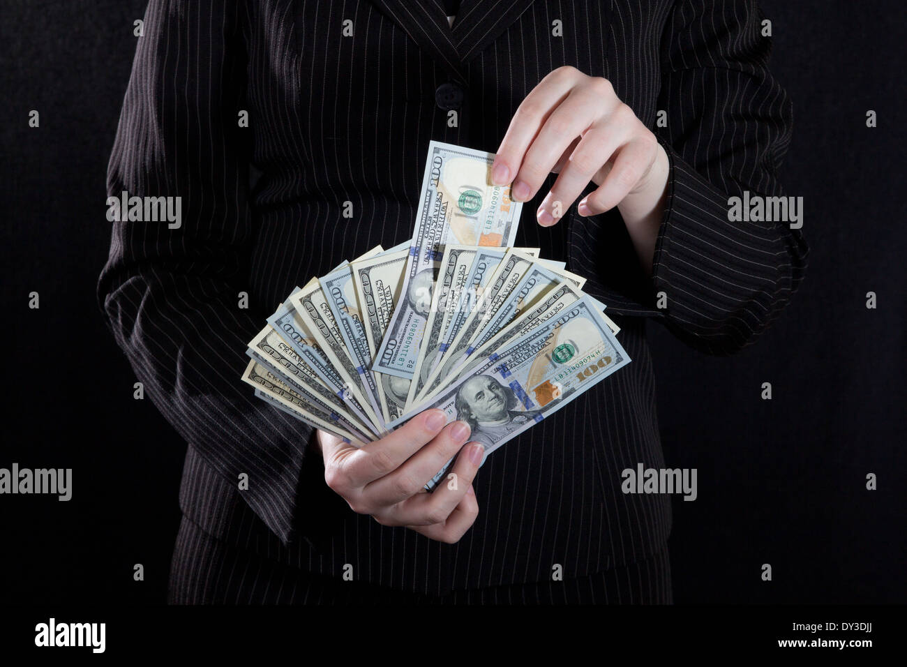 Take a banknote from cash - Stock Image