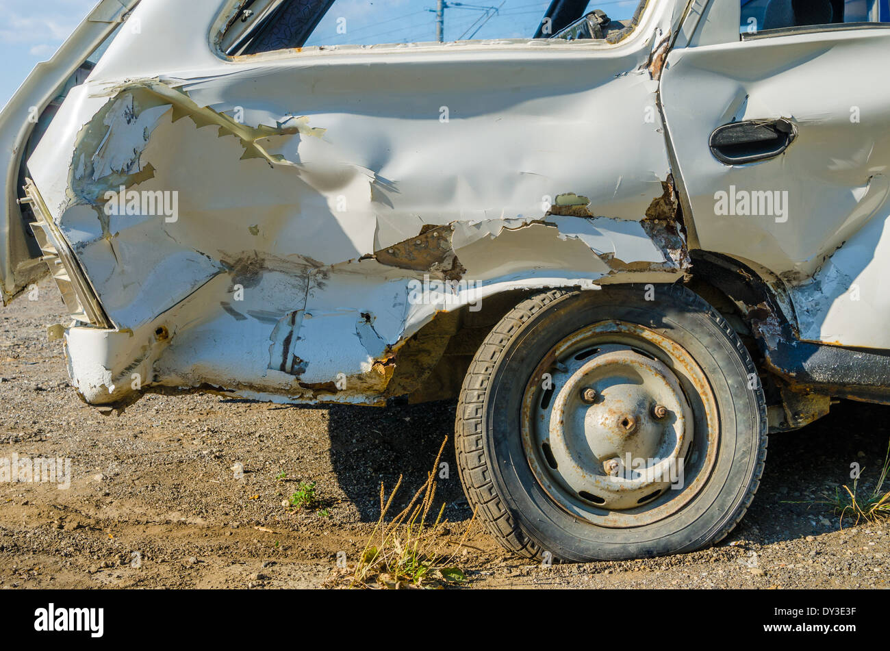 Closeup of a car that was badly damaged in a sideswipe car accident. - Stock Image