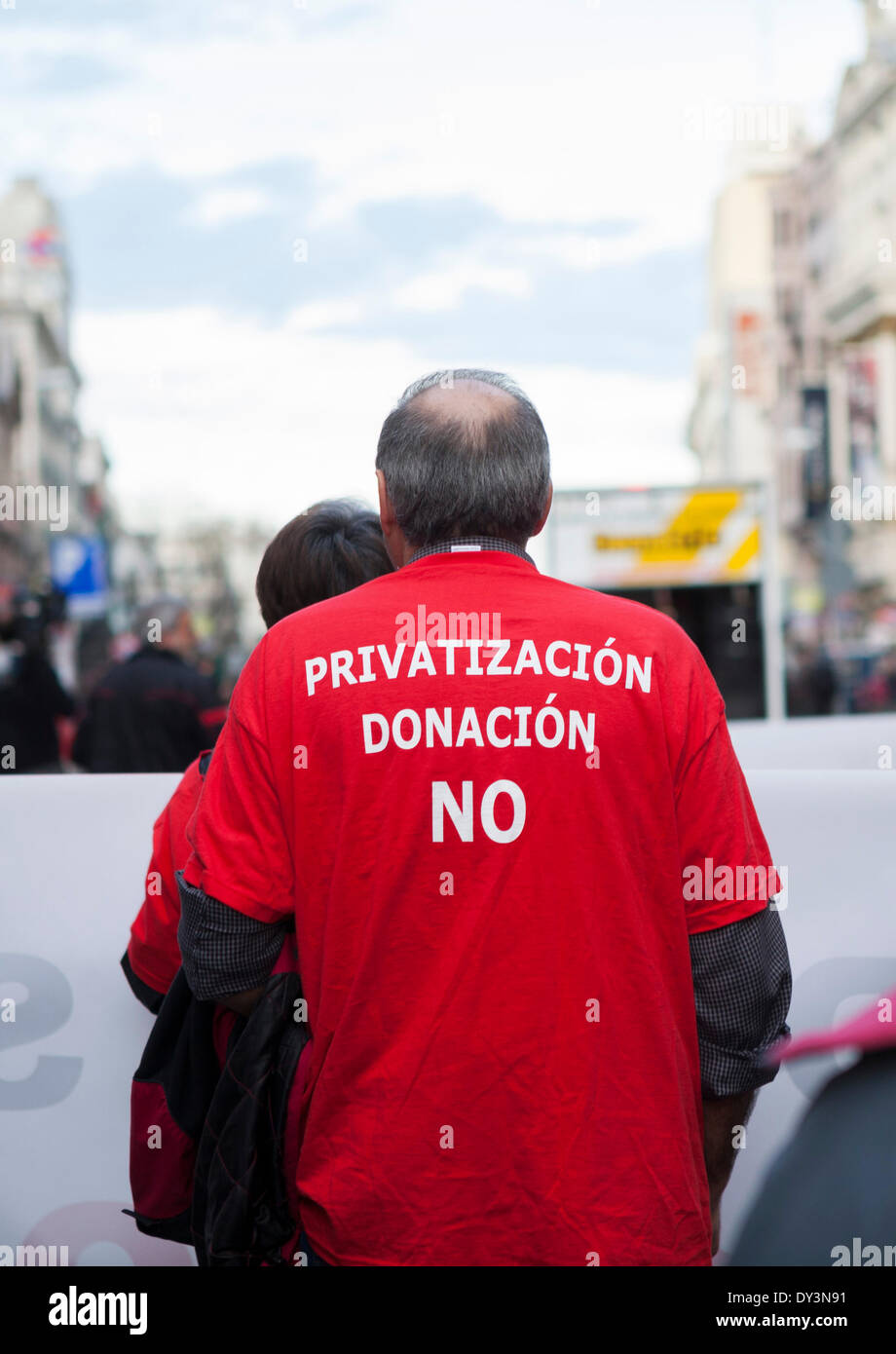Madrid, Spain. 05th Apr, 2014. A demonstrator, his vest says ' privatization, donation, no '. Approximately 1000 persons demonstrate in Madrid in opposition to the privatization of the sanitary Spanish system. The protesters asked for the return of the hospitals already privatized to the public system and the cancellation of the law 15/1997 that enables the modification of the national system of health. Credit:  Oscar Arribas/Alamy Live News - Stock Image