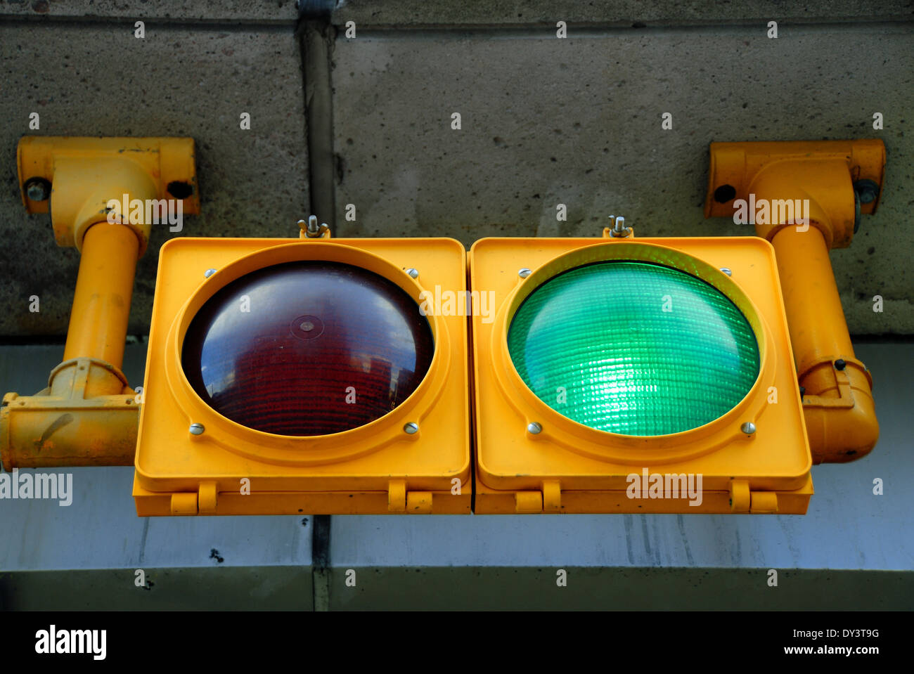 A Traffic Light At A Parking Garage Is Illuminated Green For Go