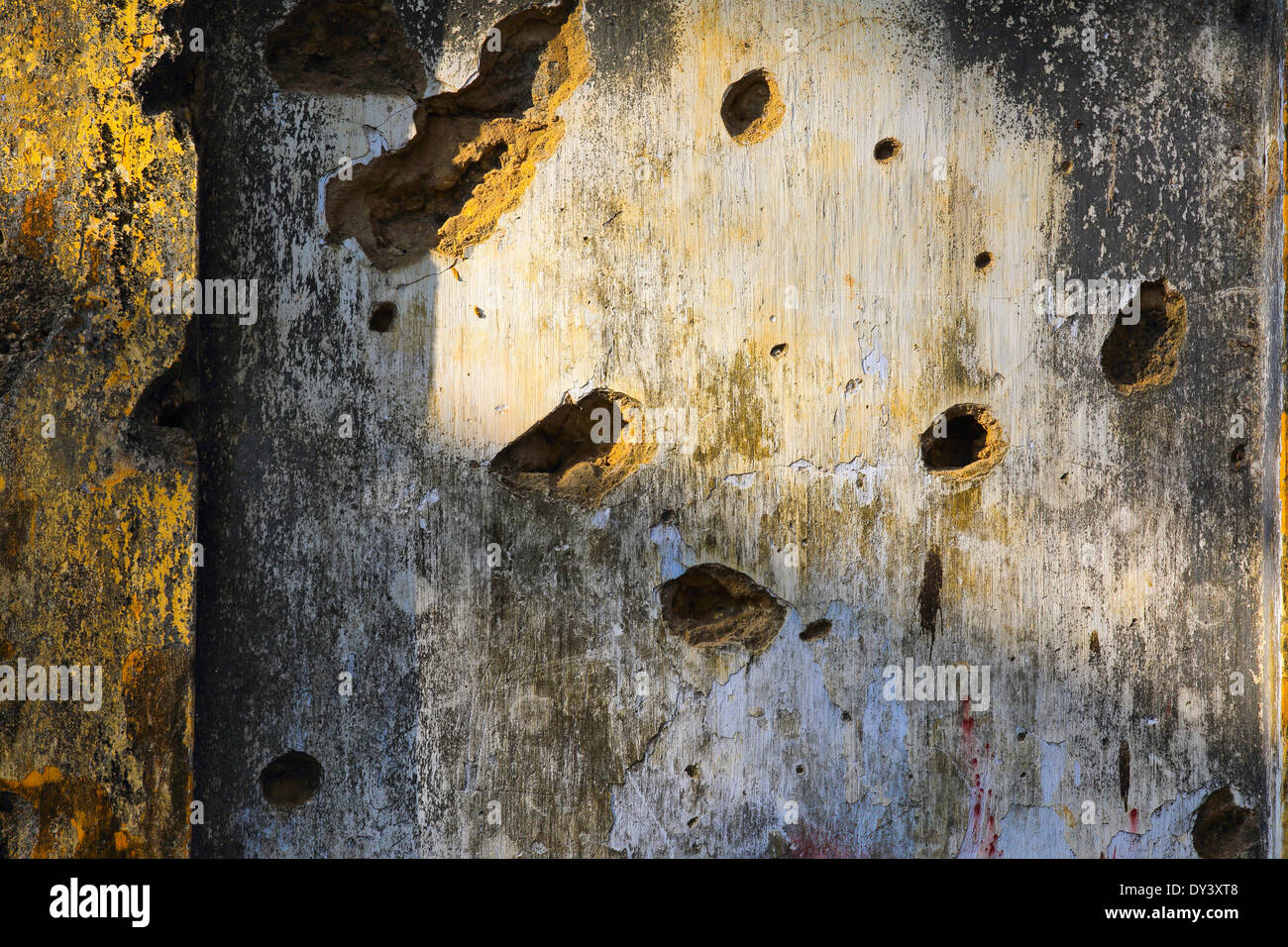 Holes in wall of old building, evidence of the brutal civil war between the Tamil Tigers and the Sri Lankan government - Stock Image