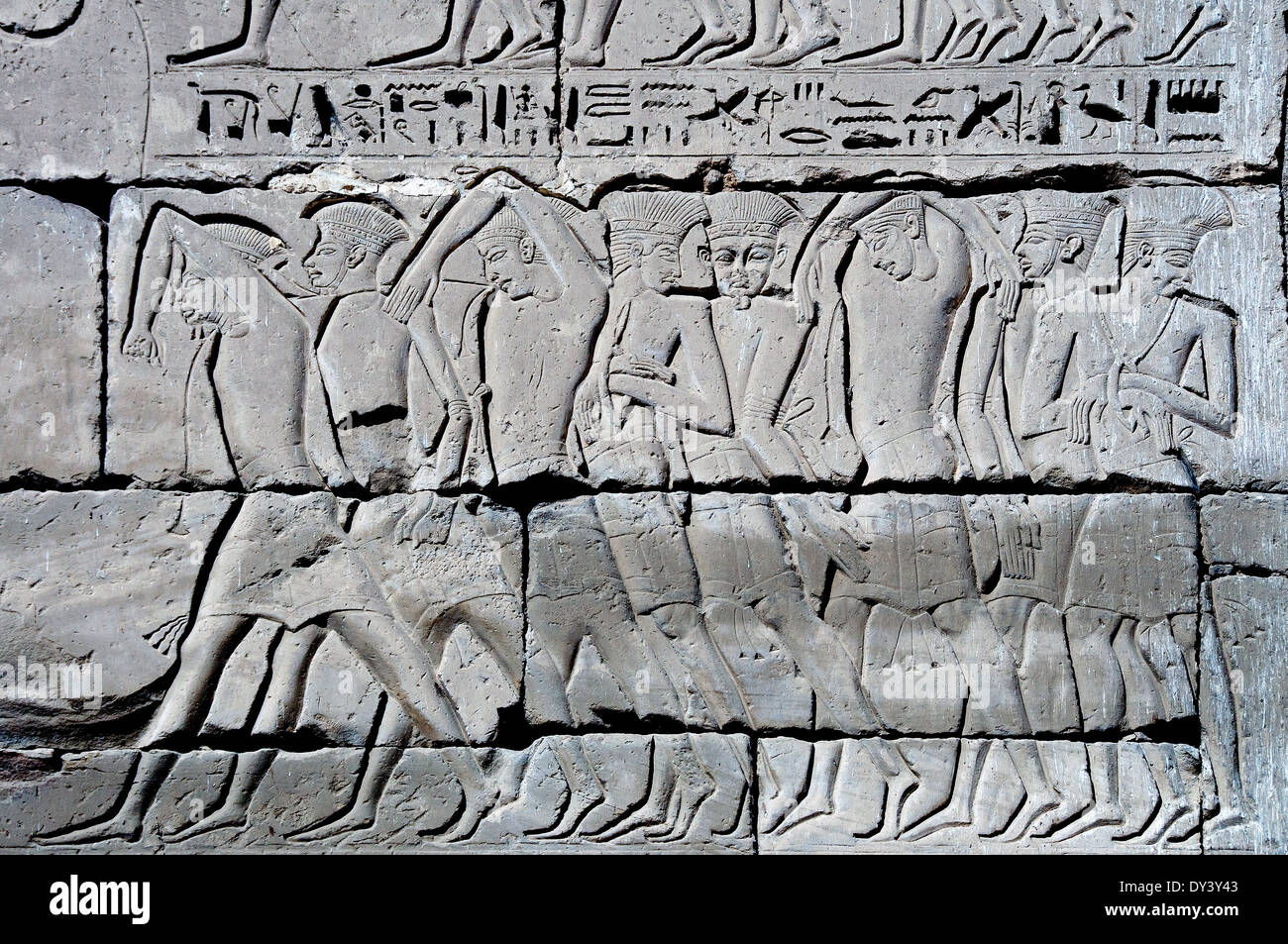 Temple of Ramses III at Medinet Habu: reliefs on the first pylon, won enemies. - Stock Image