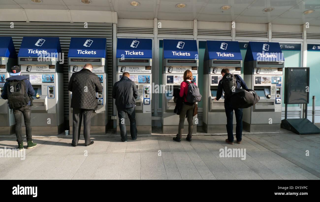 London commuters people buying train tickets at rail ticket machines outside London Bridge Railway Station in London England UK   KATHY DEWITT - Stock Image