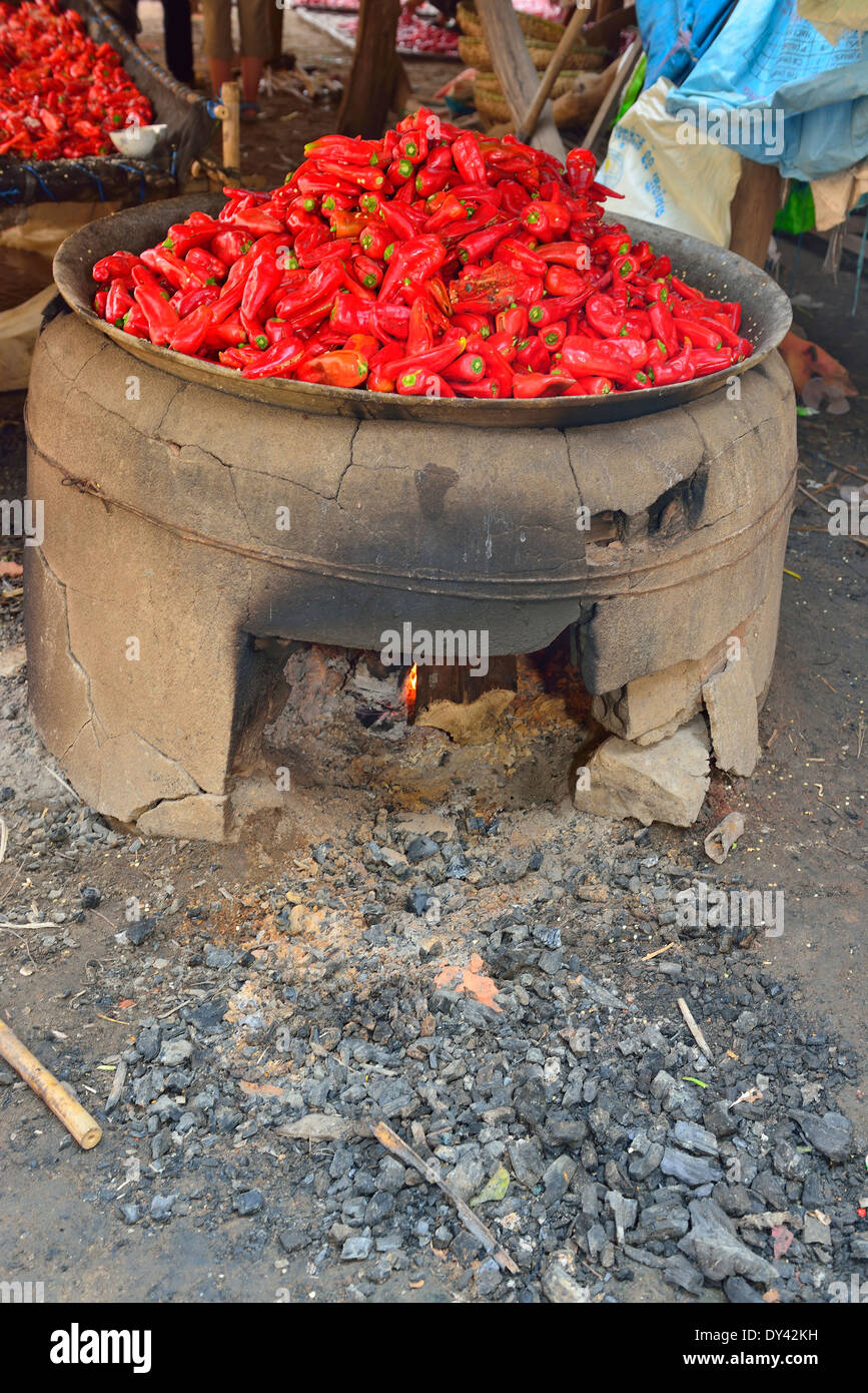 cooking chili peppers in an open fired cauldron in the preparation of a chili peppers, cottage industry ,Cambodia - Stock Image