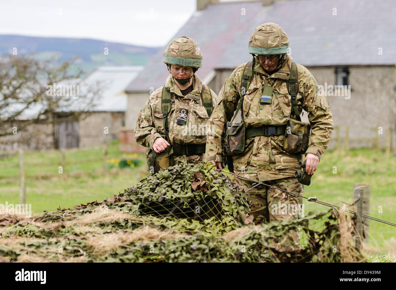 Soldiers enter a forward observation post in a rural location of Northern Ireland - Stock Image