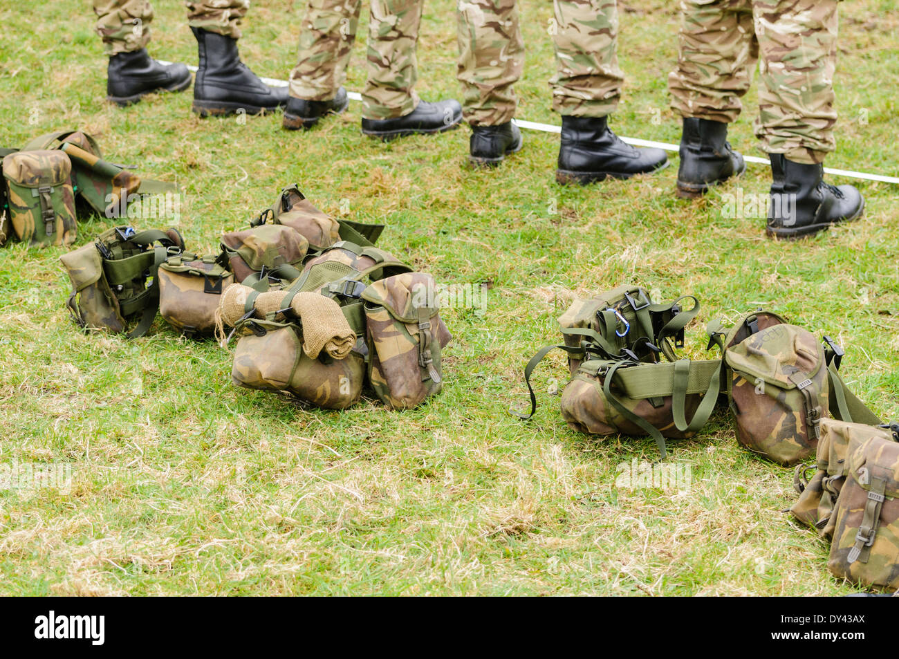Soldiers drop their kit belts as they stand in a line - Stock Image