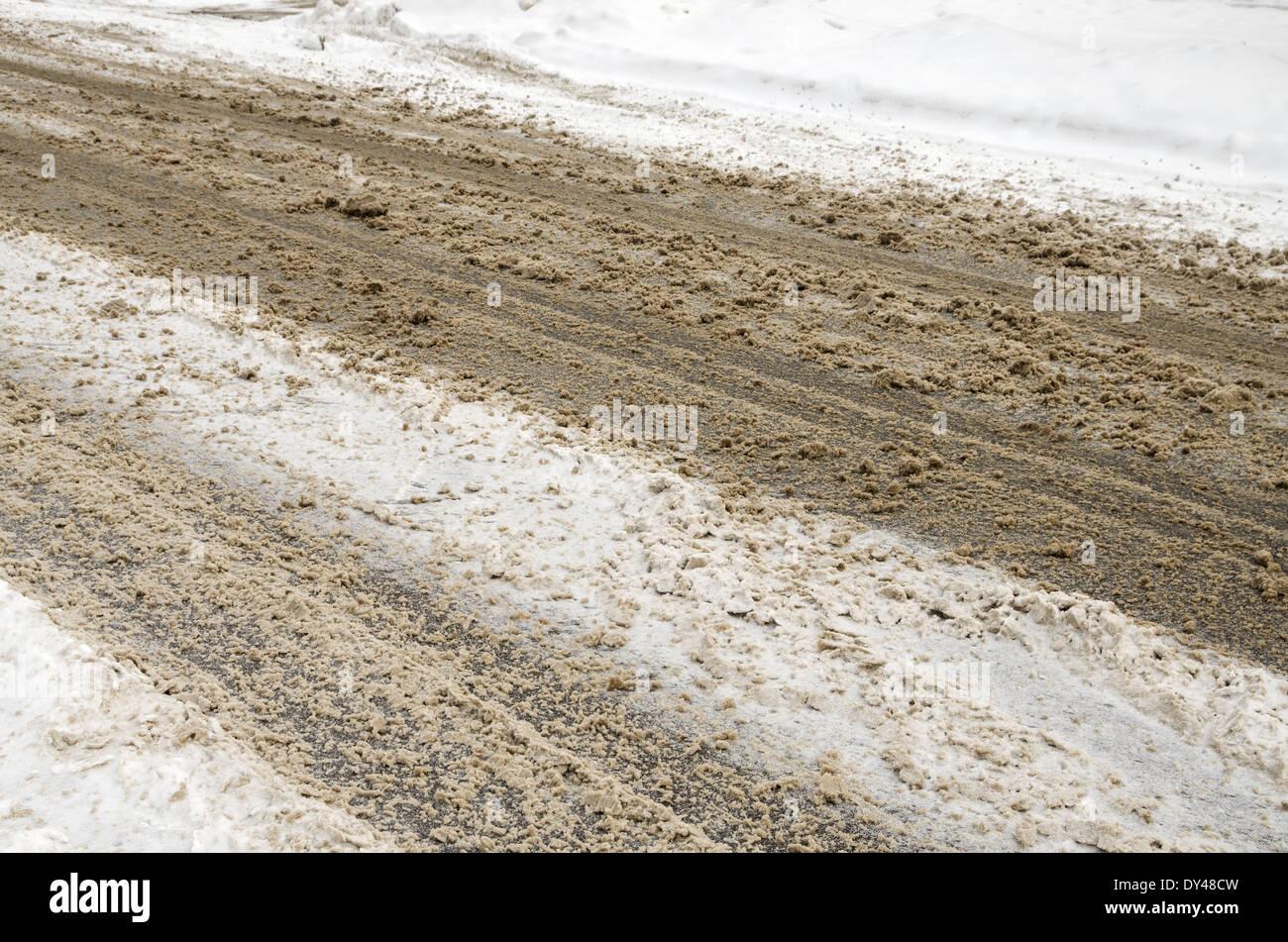 slushy winter road with hazardous driving conditions - Stock Image