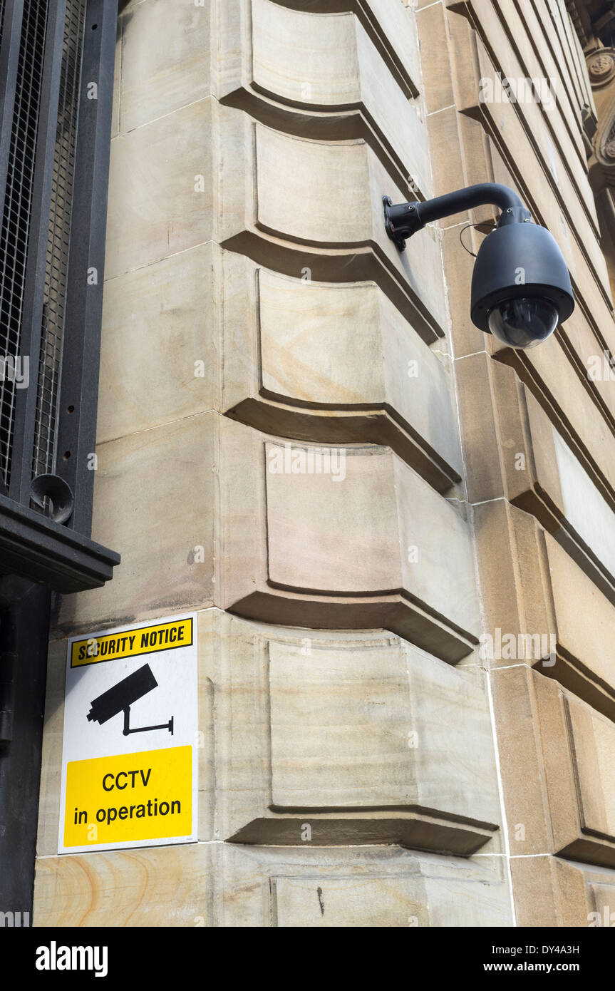 Security CCTV camera and warning sign of the exterior wall of an office building, Glasgow, Scotland, UK - Stock Image