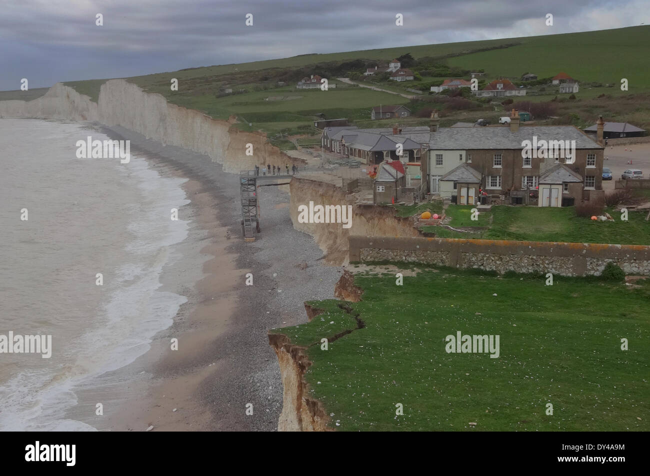Birling Gap,East Sussex, UK. 6April 2014. Coastguard cottage no3 outhouse stands alone on the cliff edge as demolition nears the final stages.The cliff face still hangs on. Photographer used specialist equipment and did not take risks.David Burr/Alamy Live News - Stock Image