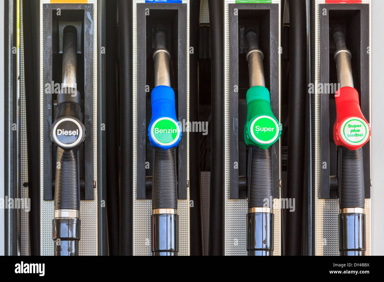 Four nozzles on a gas station in Austria, Europe offering diesel and super benzine Stock Photo
