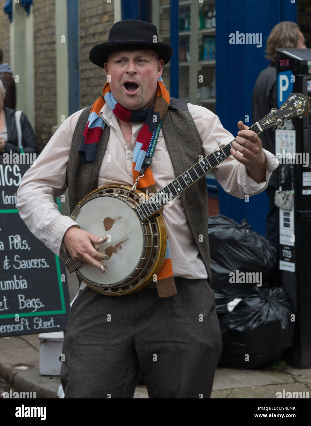street musician playing banjo. London busker. - Stock Image