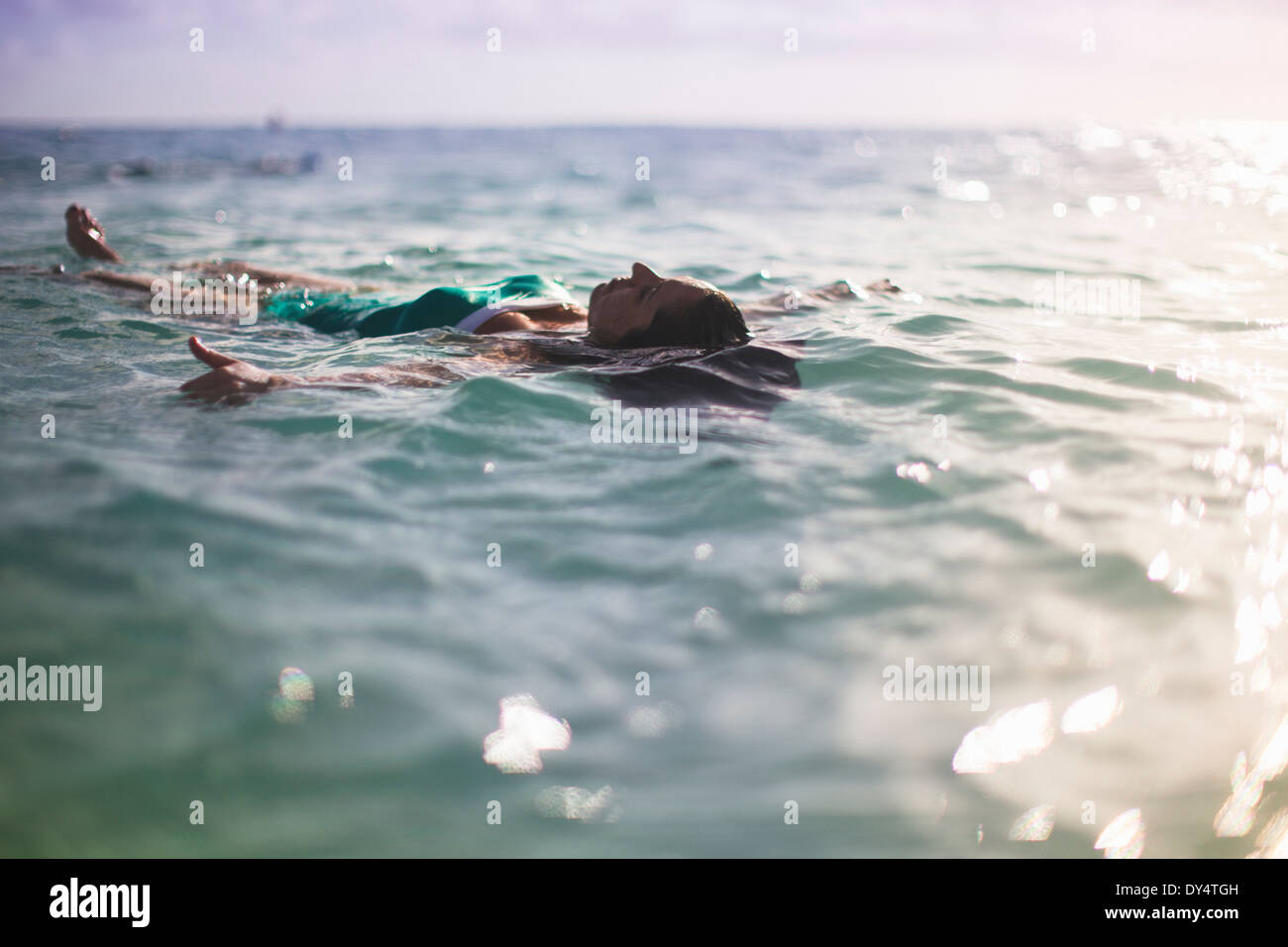 Woman floating on back in sea Stock Photo
