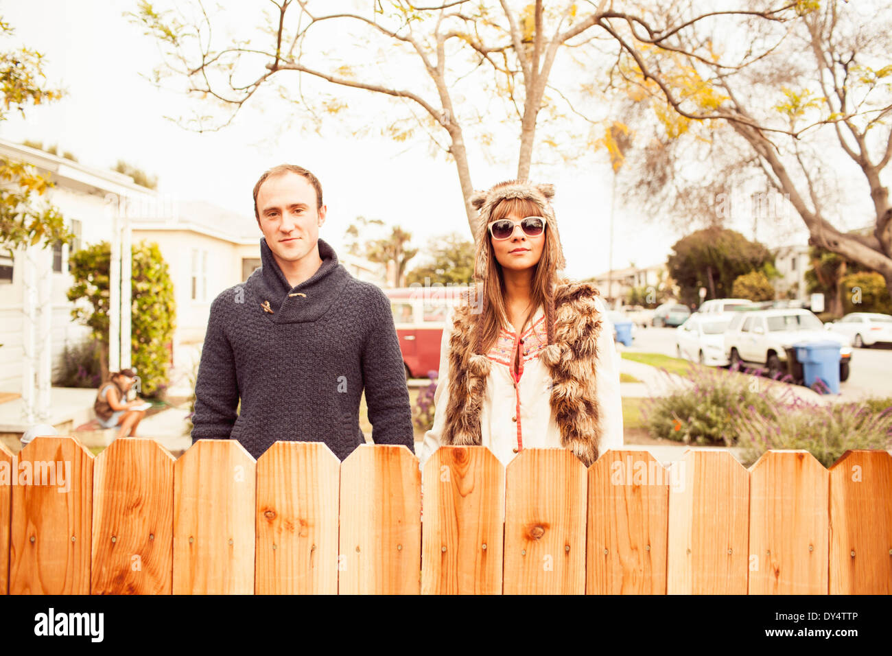 Couple behind wooden fence - Stock Image