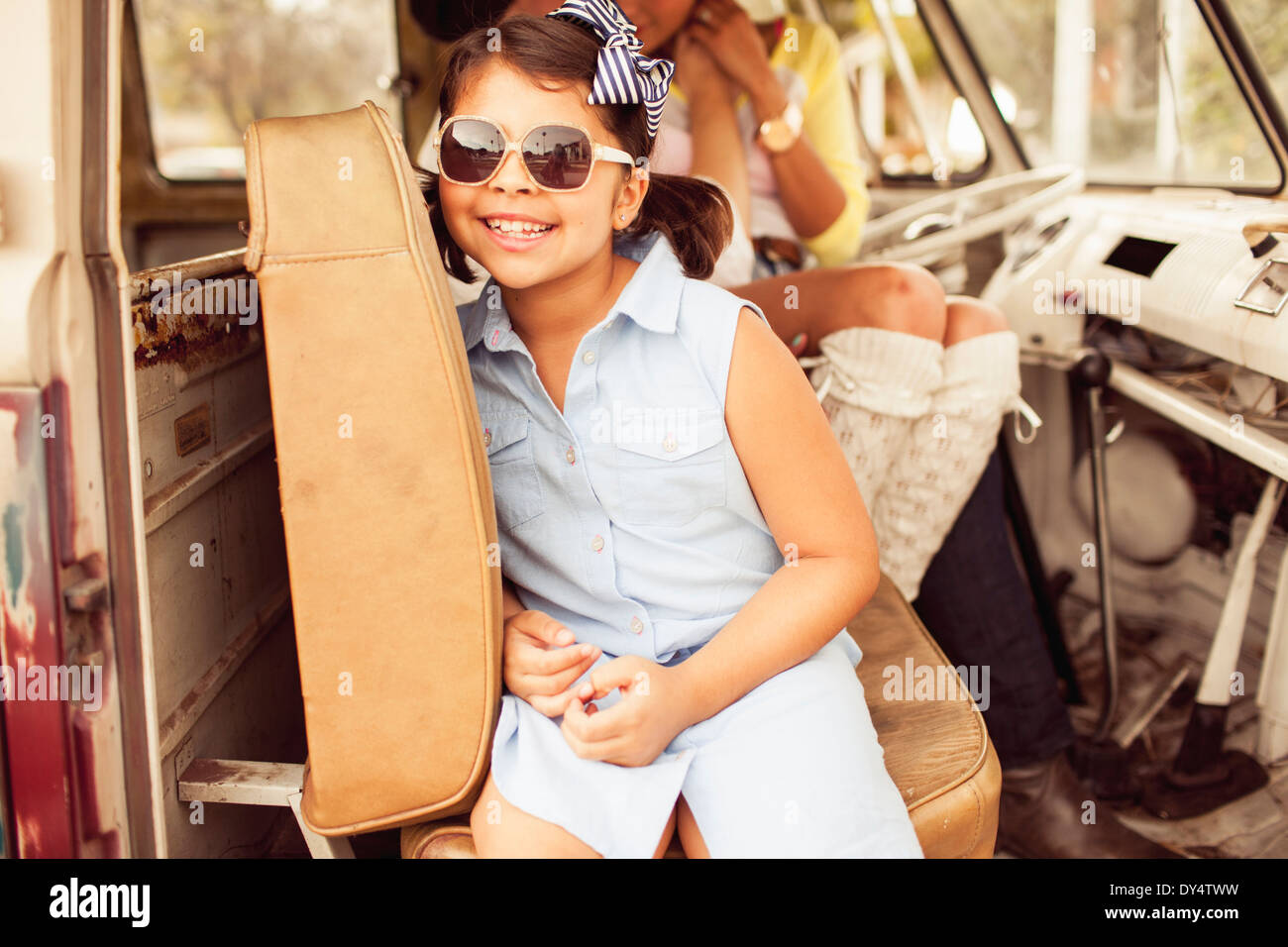 Girl wearing sunglasses in car Stock Photo