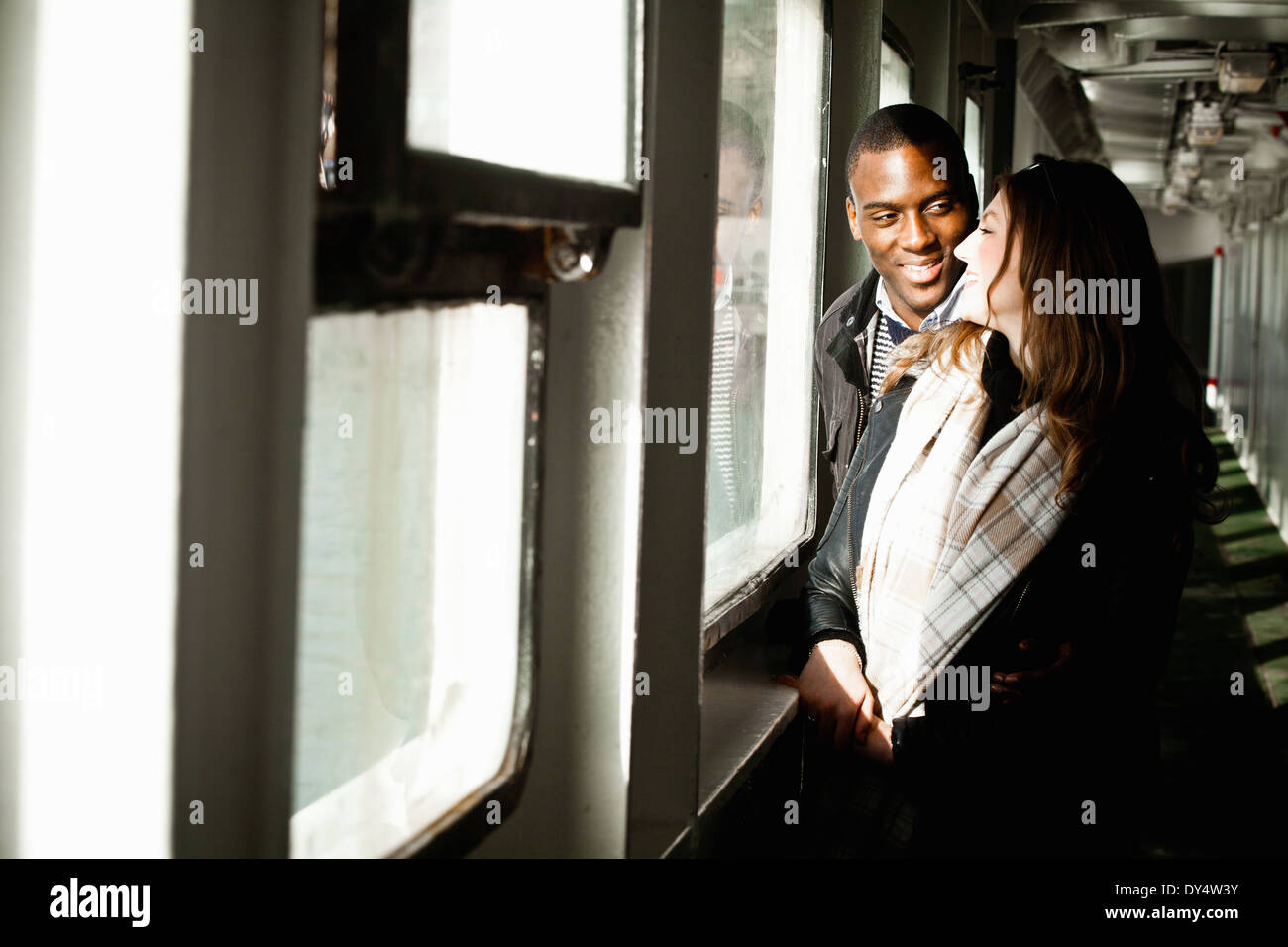 Young couple chatting in shelter - Stock Image