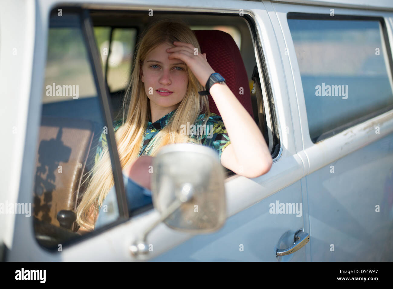 Portrait of young woman in campervan - Stock Image