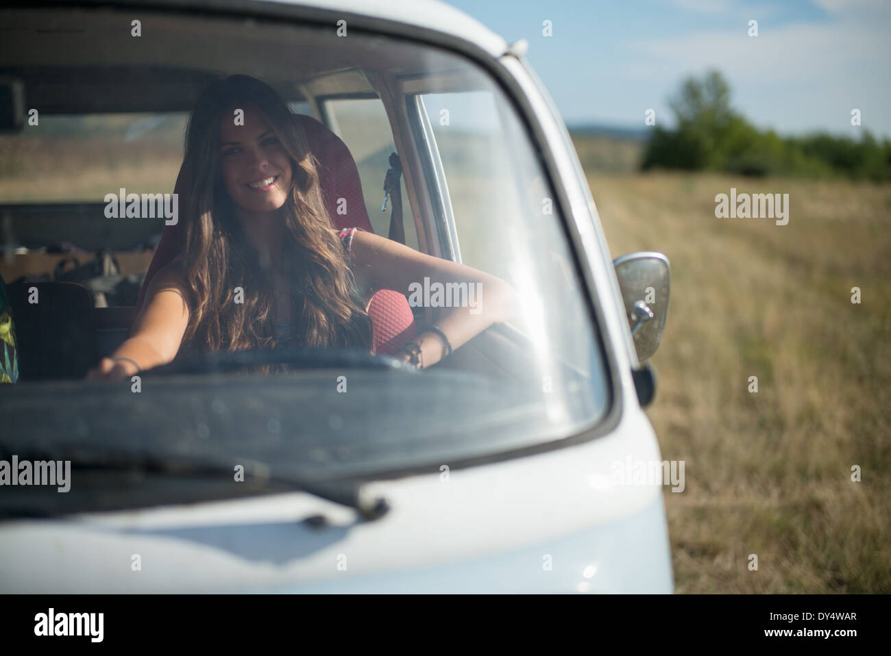 Young woman in campervan - Stock Image