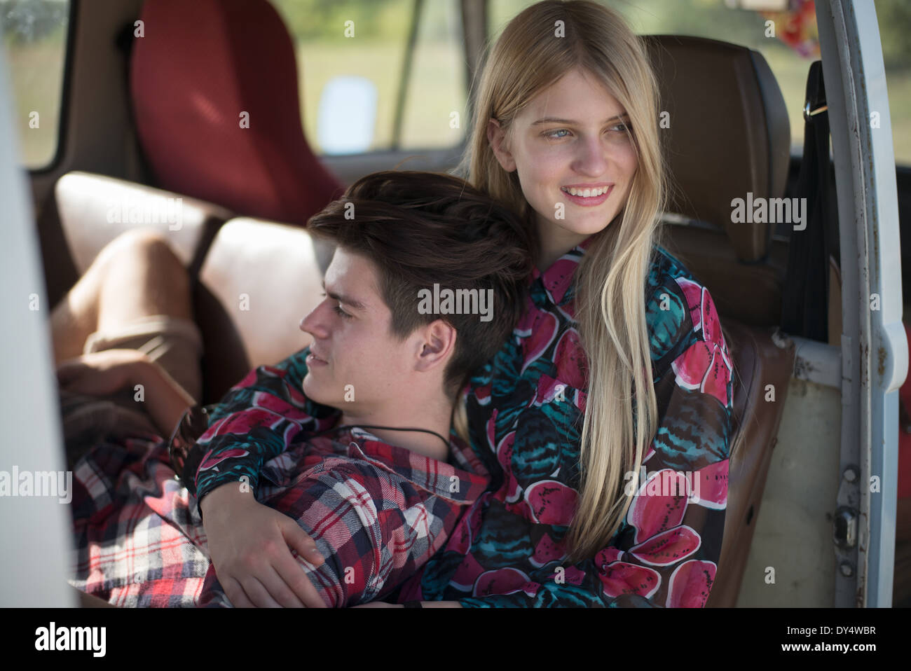 Young couple relaxing in campervan - Stock Image