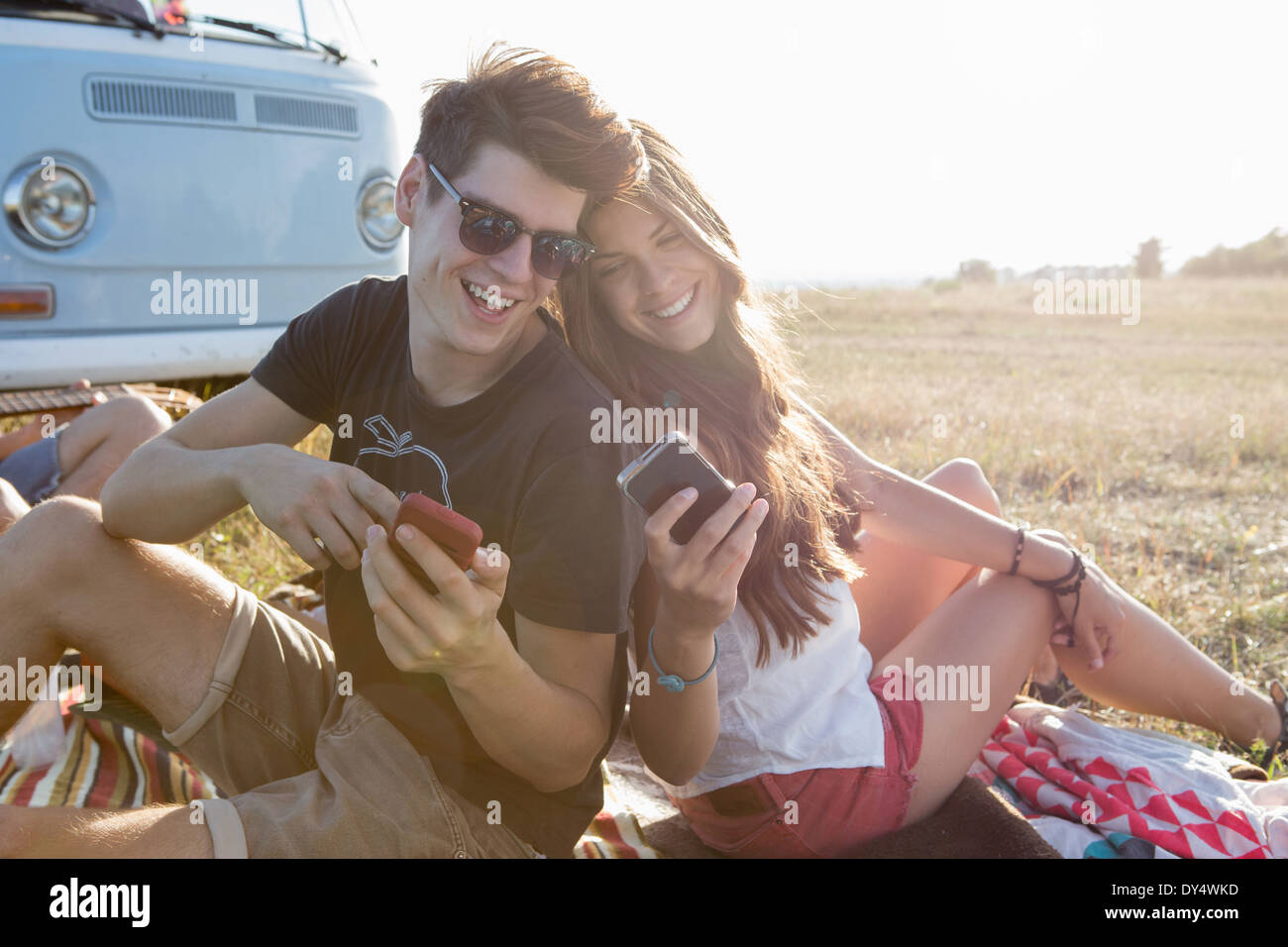 Young couple looking at smartphones - Stock Image