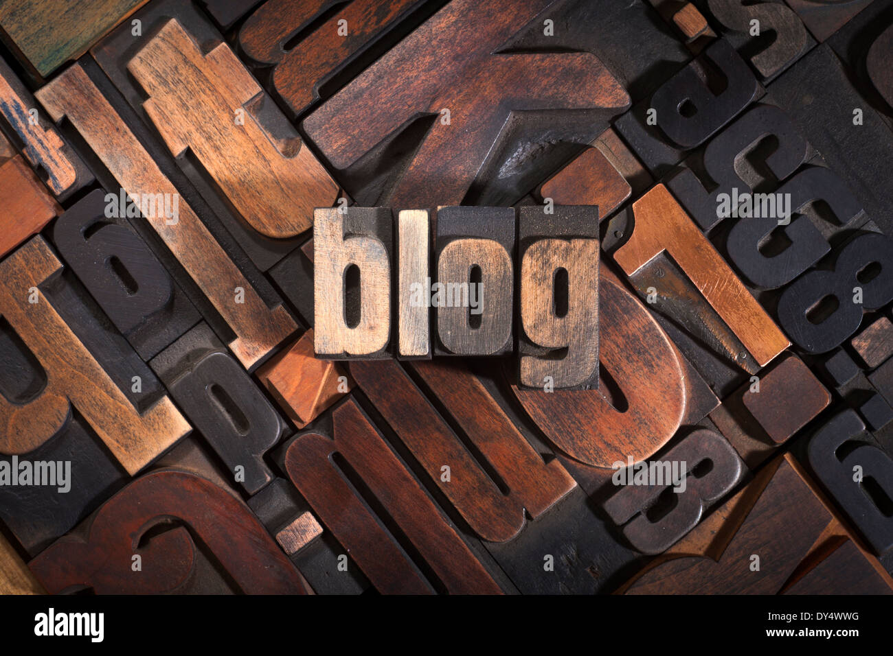 Blog, word written with antique letterpress printing blocks on random letters background - Stock Image
