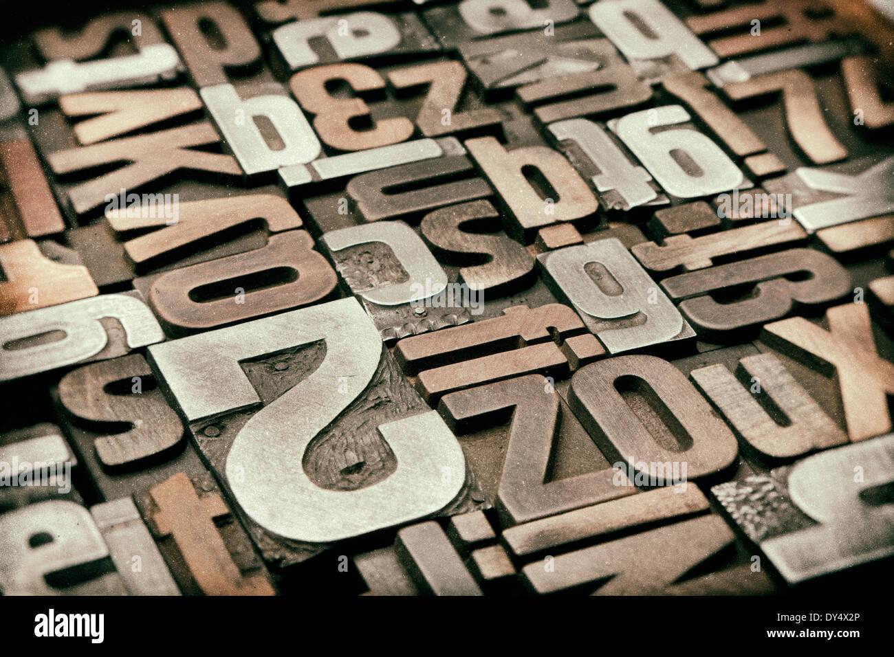 Background of antique letterpress printing blocks, vintage processing - Stock Image