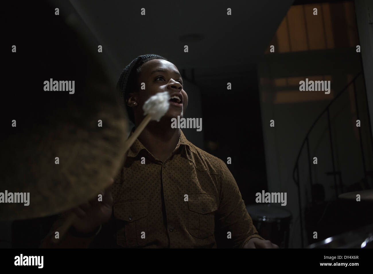 Musician playing drums - Stock Image