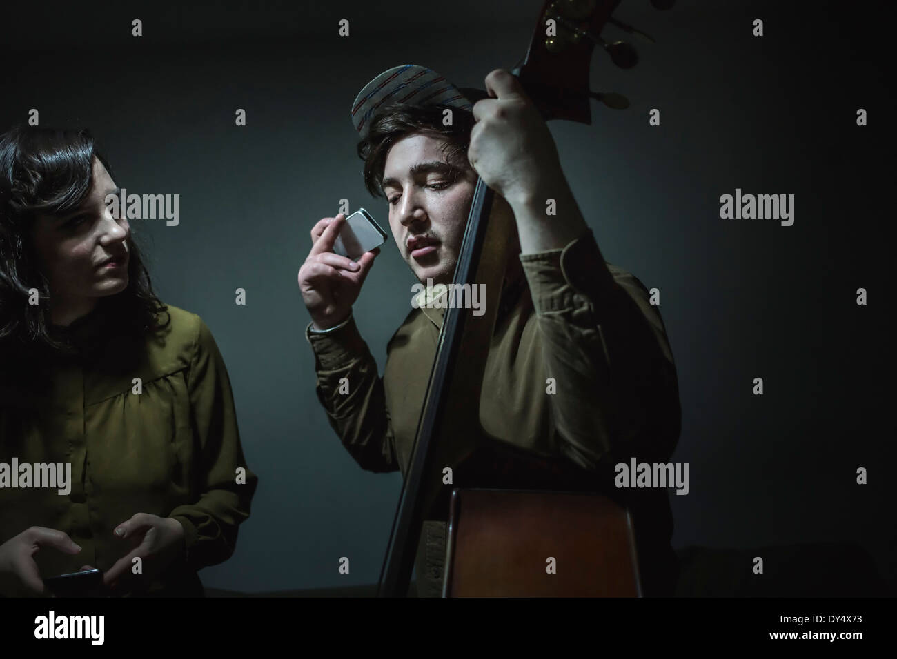 Musicians with double bass and smartphone - Stock Image