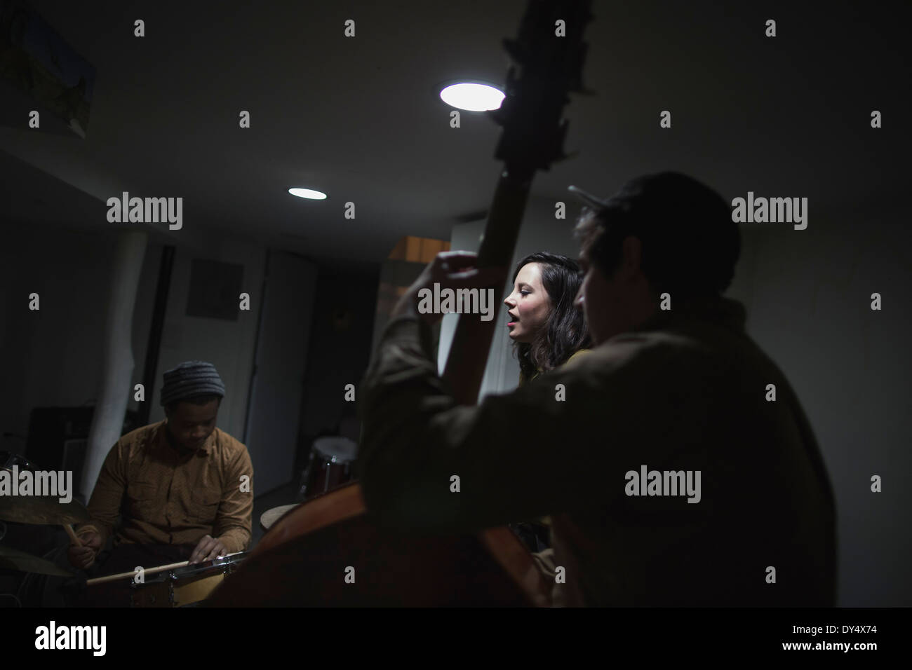 Musicians with double bass and drums - Stock Image