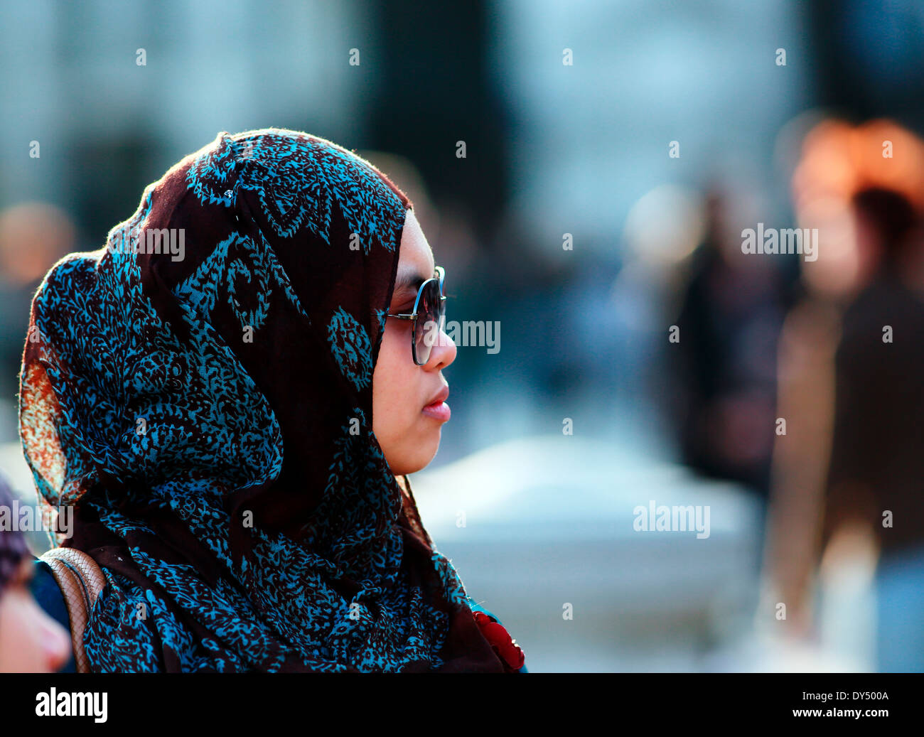 Muslim girl in head scarf - Stock Image