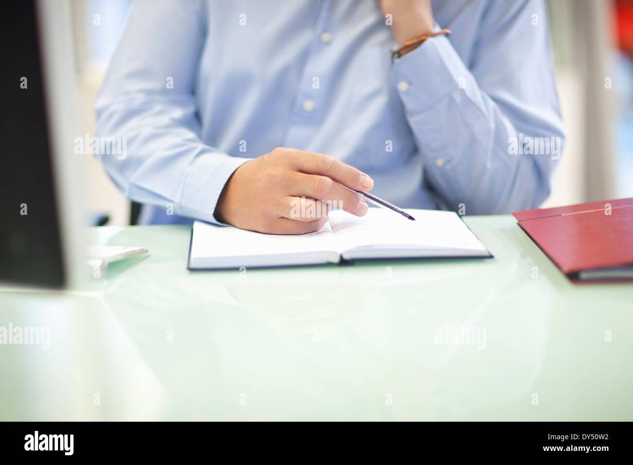 Mature businessman organizing his diary - Stock Image