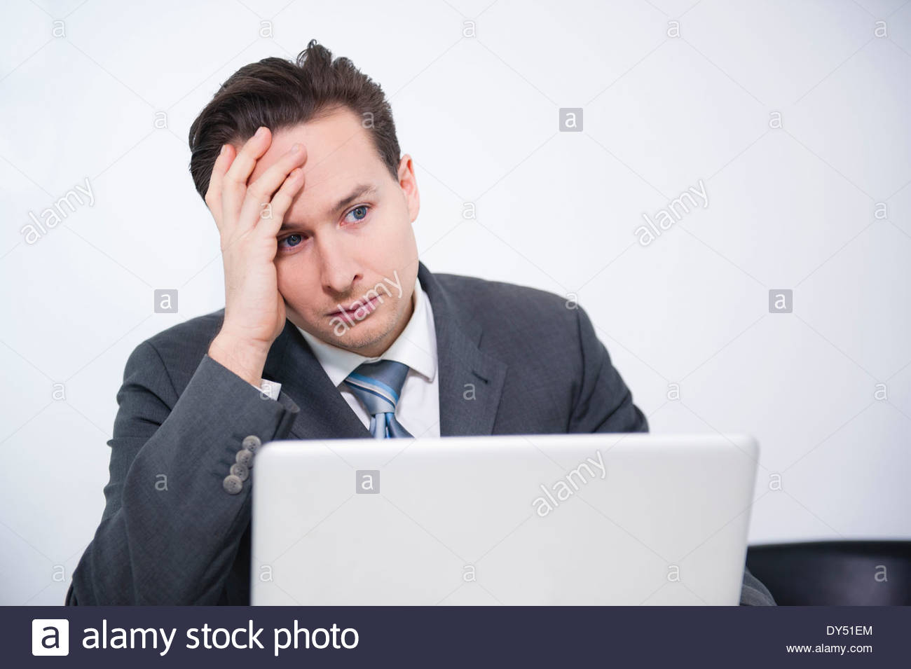 Businessman stressed out in office - Stock Image