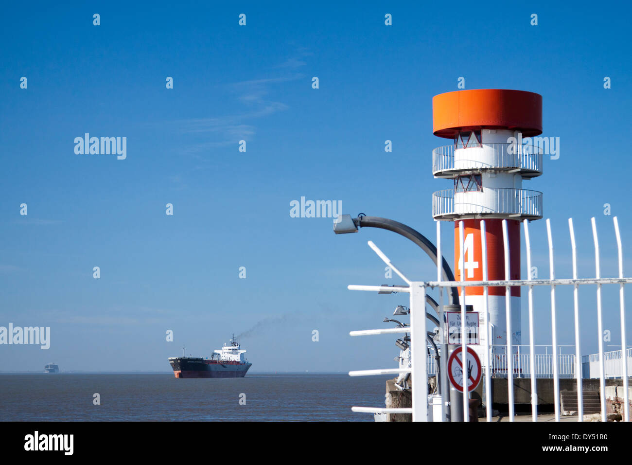 Chemical tanker Seychelles Progress seen behind a navigation light at the entrance to the Kiel Canal - Stock Image