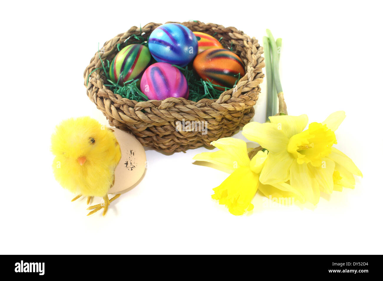Easter Basket with chick and eggs on a light background - Stock Image
