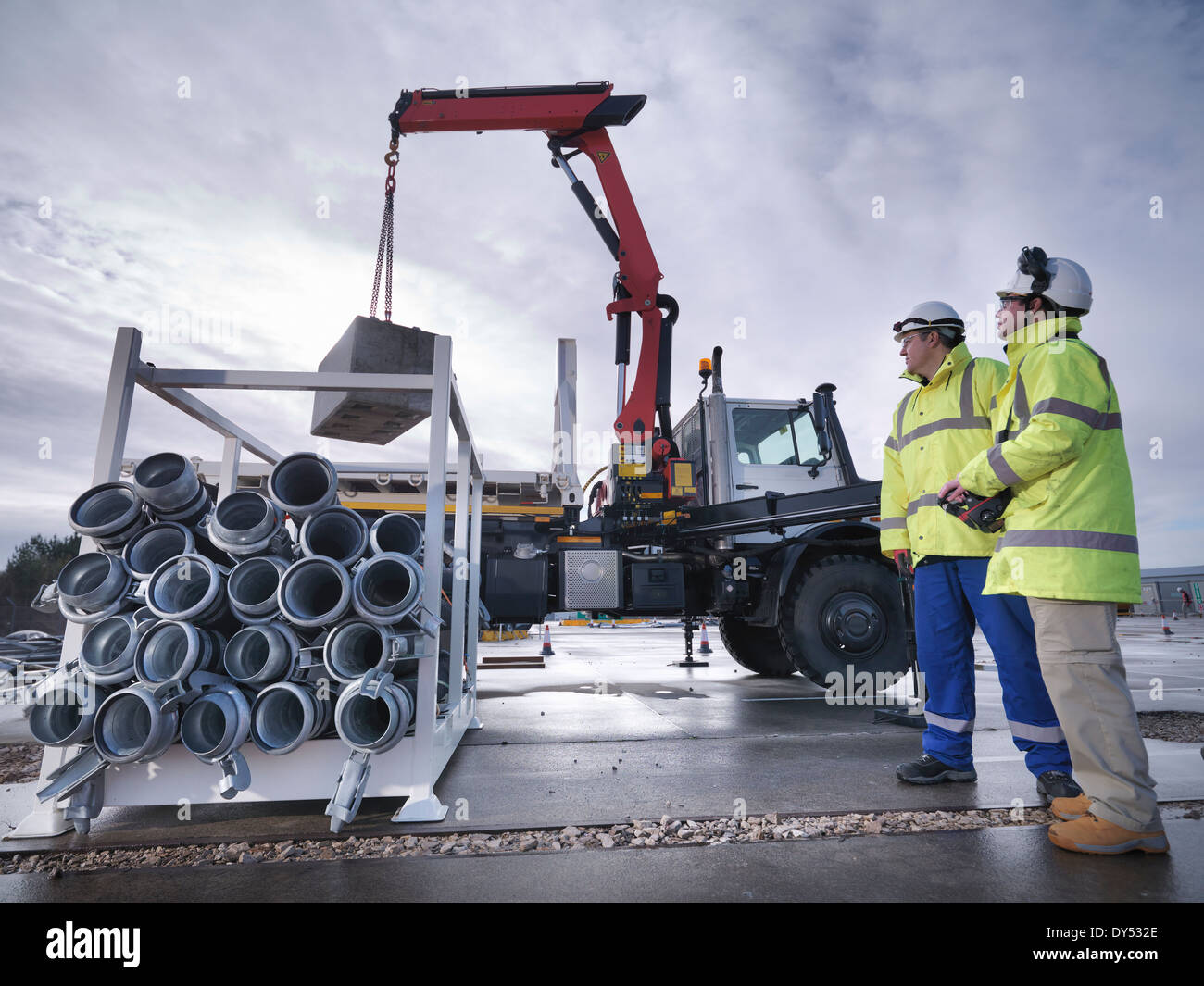 Emergency Response workers training with truck crane - Stock Image