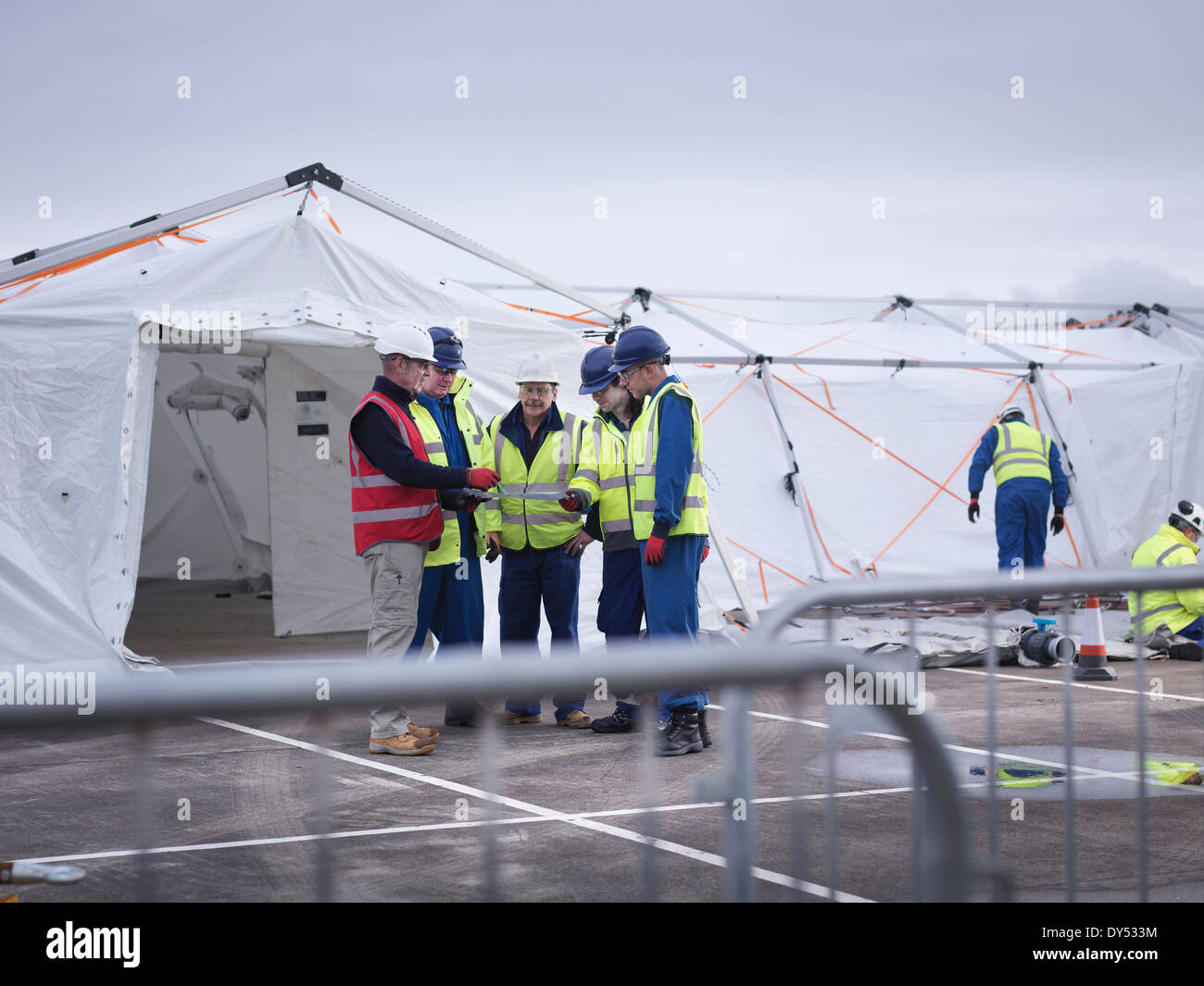 Emergency Response Team workers training in control centre tent - Stock Image