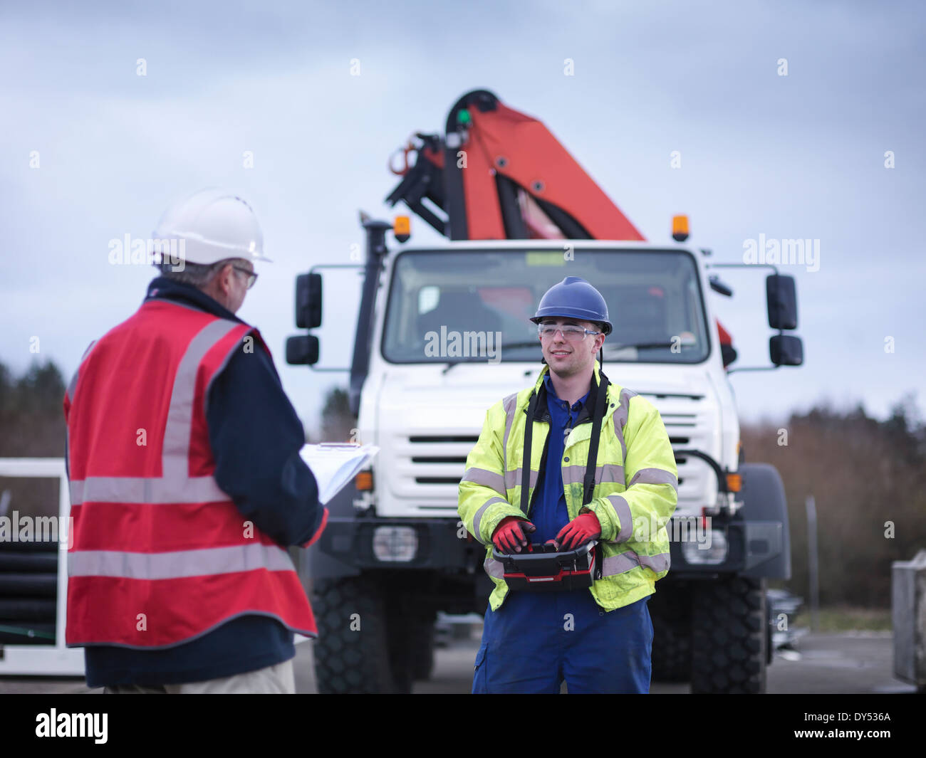 Emergency Response Team workers training with truck crane - Stock Image