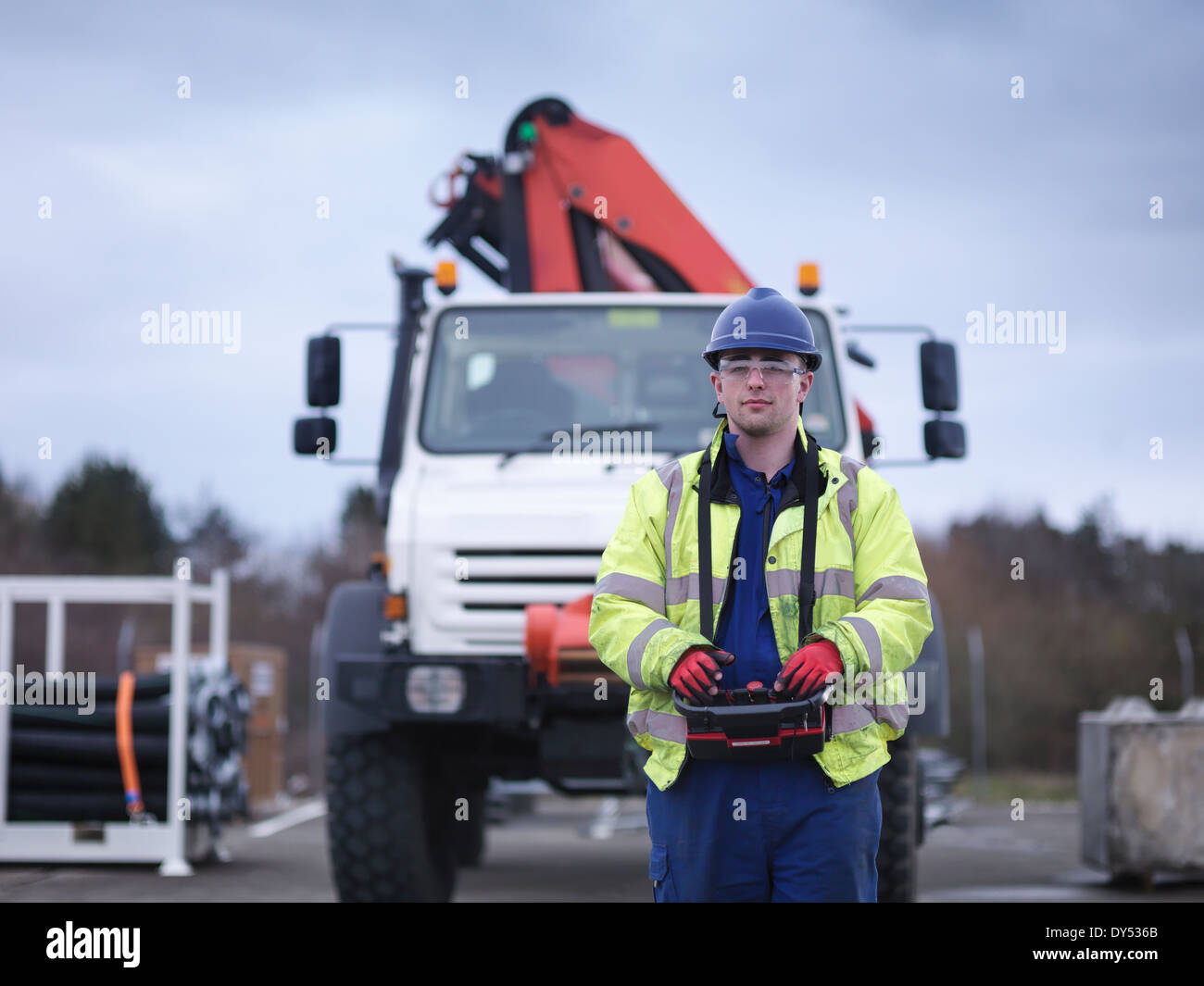Portrait of Emergency Response Team worker training with truck crane - Stock Image