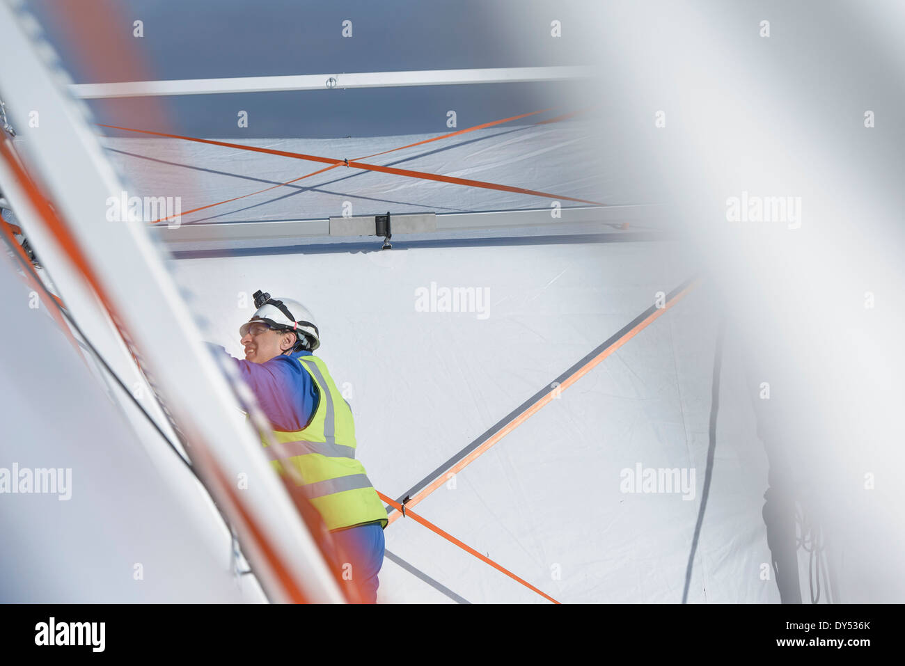Emergency Response Team worker erecting tent control centre - Stock Image